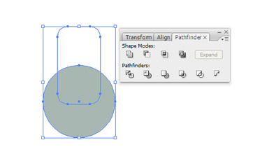 Using the Selection Tool choose both the rounded rectangle and the circle.